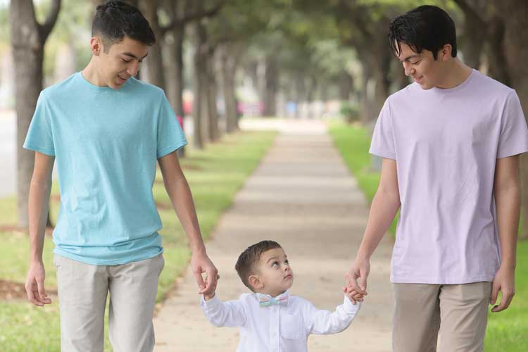 Ezekiel Cantu walking with his two brothers