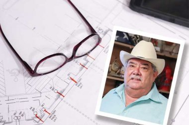 Tabletop with eyeglasses and photo of man in a hat (Eduardo Valls Jr.)